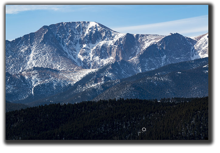 Light falls on the north face of Pikes Peak for the first time this year.