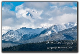 Storm clouds and snow on Pikes Peak Colorado