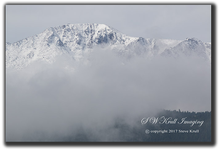 Storm clouds roll in on the north face of Pikes Peak Colorado