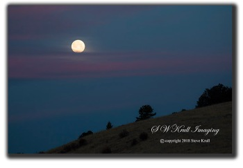 Moonset over the Sangre de Cristo Mountain Range of Colorado in the springtime