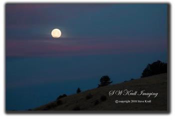 Moonset over the Sangre de Cristo Mountain Range of Colorado in the springtime