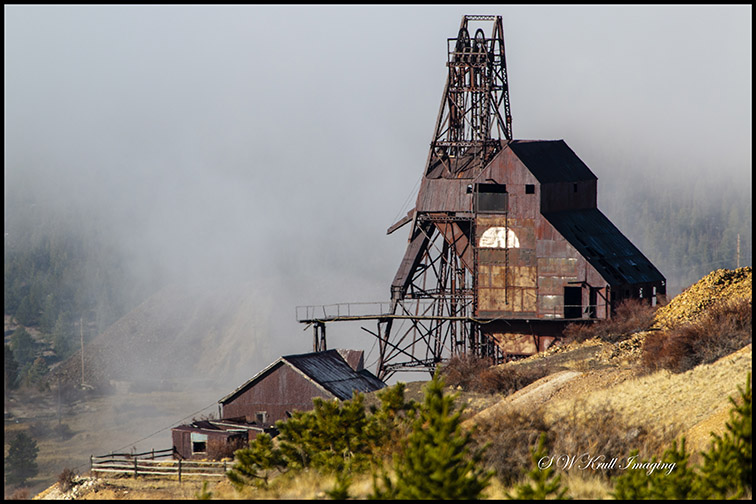 Ghostly Figures in Foggy Mine Country